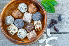 Healthy raw energy balls with cocoa, coconut, sesame, chia in a wooden bowl. royalty free stock photos