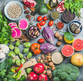 Healthy raw food variety over grey concrete background Royalty Free Stock Photos