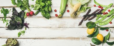 Healthy raw summer vegan ingredients over white wooden background Royalty Free Stock Photos