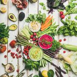 Chickpea, beetroot and spinach humus dips with fresh vegetables stock photos