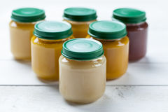 Healthy ready-made baby food on a wooden table Royalty Free Stock Photography