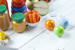 Healthy ready-made baby food on a wooden table Royalty Free Stock Photos