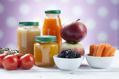 Healthy ready-made baby food on a wooden table Stock Image