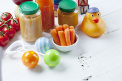 Healthy ready-made baby food on a wooden table Stock Images