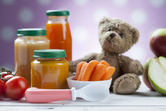 Healthy ready-made baby food on a wooden table Stock Photography