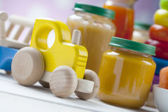 Healthy ready-made baby food on a wooden table Royalty Free Stock Image