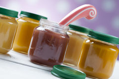 Healthy ready-made baby food on a wooden table Royalty Free Stock Photo