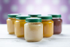 Healthy ready-made baby food on a wooden table Royalty Free Stock Images