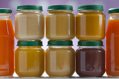 Healthy ready-made baby food on a wooden table Stock Photo