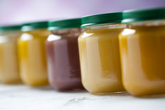 Healthy ready-made baby food on a wooden table Stock Photos