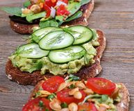 Healthy recipe toast topped with vegetables stock images