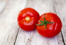 Healthy red fresh tomatoes on wooden board royalty free stock images