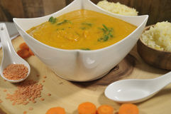 Healthy red lentil carrot soup stock image