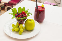 Healthy red smoothie and ingredients - superfoods, detox, diet, health, vegetarian food concept. Royalty Free Stock Photos