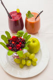 Healthy red smoothies and ingredients - superfoods, detox, diet, health, vegetarian food concept. Stock Photo