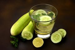 Healthy and refreshing drink with Cucumber, Mint and Lemon royalty free stock photos
