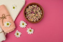 Healthy relaxation, therapy and treatment. Towels and flowers stock image