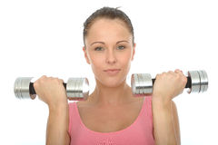 Healthy Relaxed Happy Young Woman Training With Dumb Bell Weights Royalty Free Stock Photography