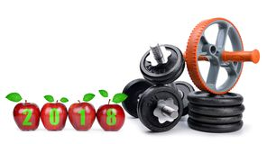 Healthy resolutions for the New Year 2018. Red apples and dumbbells isolated on white background. Healthy resolutions for the New Year 2018 Royalty Free Stock Image