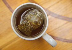 Healthy restorative drink. teabag in a cup of tea Royalty Free Stock Photos