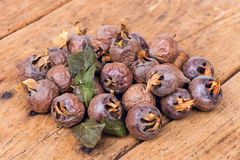 Healthy ripe Medlars on the old wooden table Royalty Free Stock Photography