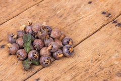 Healthy ripe Medlars on the old wooden table Stock Photo