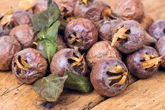 Healthy ripe Medlars on the old wooden table Royalty Free Stock Photo