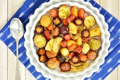 Roasted root vegetables from overhead. Healthy roasted root vegetables from overhead in horizontal format and shot in natural light Royalty Free Stock Image