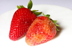 Healthy and rotten spoiled bad red strawberries Royalty Free Stock Images