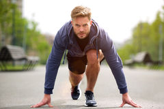 Healthy runner in starting position outside Royalty Free Stock Image