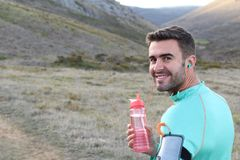 Healthy runner taking a break to drink some water.  Stock Images