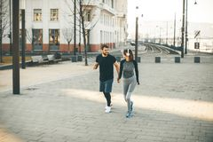 Healthy runners running in city with cityscape in background royalty free stock photography