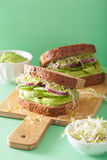 Healthy rye sandwich with avocado cucumber alfalfa sprouts Stock Images