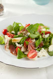 Healthy salad. Delicious salad with fresh greens, tomatoes, roquefort and pear Royalty Free Stock Photography