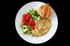 Healthy salad. Quinoa cucumber tomato avocado and bread Royalty Free Stock Image