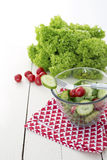 Healthy salad. Fresh garden salad with spinach, cucumber and tomato in a glass bowl stock photo