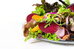 Healthy salad. With beet, lettuce, orange, onion, almonds and ham Stock Photos