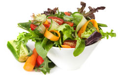 Healthy Salad. With mixed greens, carrot, cucumber, tomatoes, string beans, and bell pepper Royalty Free Stock Image