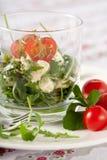 Healthy salad. Delicious healthy salad with feta cheese, rocket and mozarella Royalty Free Stock Image