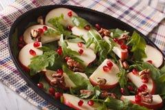 Healthy salad with apples, pomegranates, walnuts and arugula Stock Photo