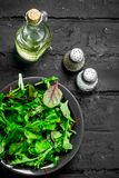 Healthy salad. Arugula salad in a bowl. On a black rustic background stock photos