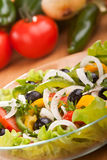 Healthy salad with black olives Stock Images