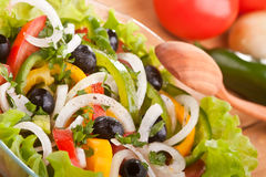 Healthy salad with black olives Stock Photo