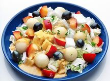 Healthy salad on blue plate Stock Photo
