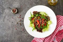 Healthy salad bowl with beef meat, sweet peppers, onions stock photos