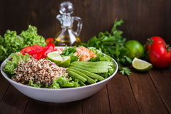 Healthy salad bowl with quinoa, tomatoes, chicken, avocado, lime and mixed greens, lettuce, parsley Stock Photography