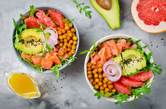 Healthy salad bowl with salmon, grapefruit, spicy chickpeas, avo Royalty Free Stock Photo