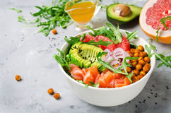 Healthy salad bowl with salmon, grapefruit, spicy chickpeas, avo Stock Photography