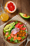Healthy salad bowl with salmon, grapefruit, spicy chickpeas, avo Royalty Free Stock Photos
