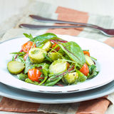 Healthy salad with brussels sprouts cabbage , tomatoes, salad Royalty Free Stock Photo